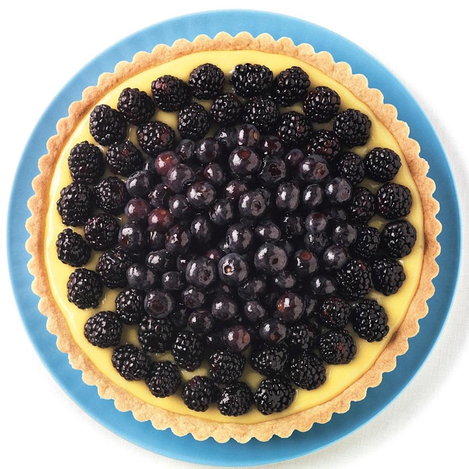 "A press-in crust makes this 4th of July dessert easy to put together. For a pretty presentation, don't cover the lime curd completely with berries. The contrast between the dark berries and the bright lime curd is striking. <a href=""https://www.epicurious.com/recipes/food/views/lime-tart-with-blackberries-and-blueberries-359373?mbid=synd_yahoo_rss"" rel=""nofollow noopener"" target=""_blank"" data-ylk=""slk:See recipe."" class=""link rapid-noclick-resp"">See recipe.</a>"