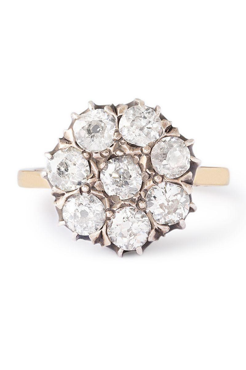 "<p><strong><em>Fox & Bond </em></strong><em>14k Austrian Old Mine Cut Diamond Cluster Ring, circa the 1870s-1890s, $3,170, <a href=""https://foxandbond.com/collections/engagement-rings/products/austrian-old-mine-cut-diamond-silver-and-14k-gold-cluster-ring"" rel=""nofollow noopener"" target=""_blank"" data-ylk=""slk:foxandbond.com"" class=""link rapid-noclick-resp"">foxandbond.com</a></em></p><p><a class=""link rapid-noclick-resp"" href=""https://foxandbond.com/collections/engagement-rings/products/austrian-old-mine-cut-diamond-silver-and-14k-gold-cluster-ring"" rel=""nofollow noopener"" target=""_blank"" data-ylk=""slk:SHOP"">SHOP</a></p>"