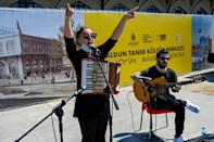 Some musicians like Ozge Metin (L) have been invited to perform in open squares