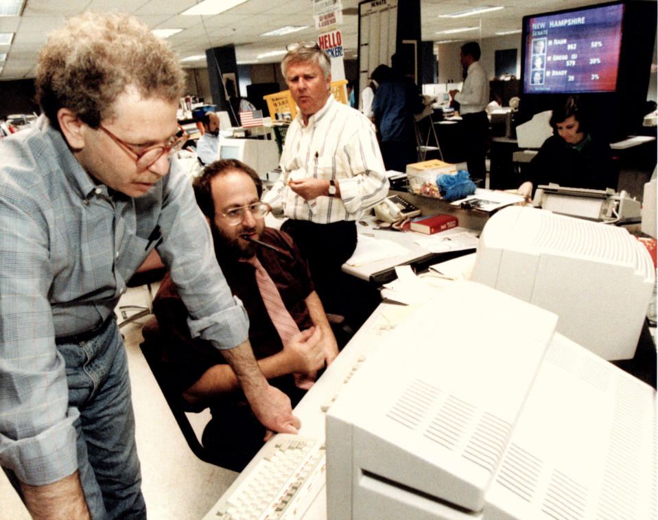 Associated Press journalists David Espo, bureau chief Jonathan Wolman and Walter Mears work on Election Day, November 1992, in Washington. (AP Photo)