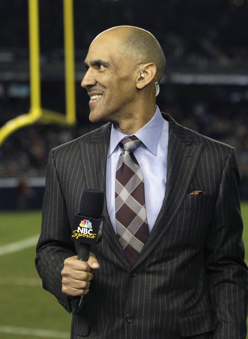 In this Nov. 20, 2010 photo, NBC football analyst and former Indianapolis Colts head coach Tony Dungy works on the sideline during halftime of the Army/Notre Dame NCAA college football game at Yankee Stadium in New York. (AP Photo/Kathy Willens)