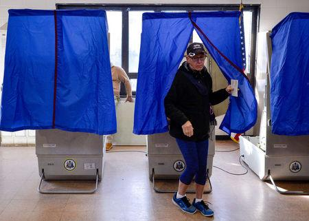 FILE PHOTO: A voter leaves the polling booth during the U.S. presidential election in Philadelphia, Pennsylvania, U.S. November 8, 2016.  REUTERS/Charles Mostoller/File Photo