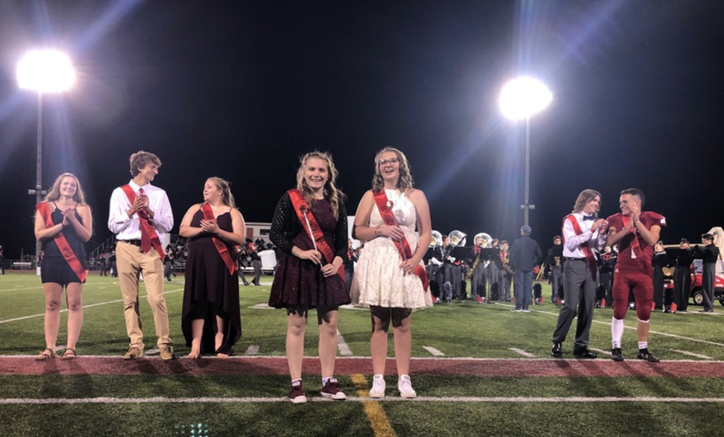 Milford High School's Homecoming Royalty, Abbey Stropes and Trinity Miller, received their scepters in front of their Homecoming Court on Friday. (Photo: Milford Schools via Facebook)