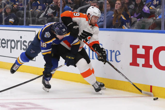 Philadelphia Flyers defenseman Ivan Provorov (9) of Russia beats St. Louis Blues center Robert Thomas (18) to the puck during the second period of an NHL hockey game Wednesday, Jan. 15, 2020 in St. Louis. (AP Photo/Dilip Vishwanat)