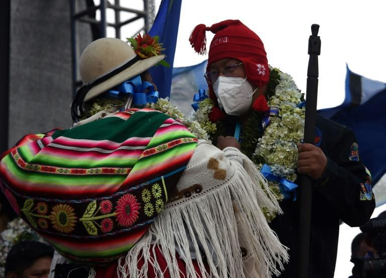 Leftist presidential candidate Luis Arce dances with an indigenous woman during the closing rally of his campaign in El Alto, Bolivia