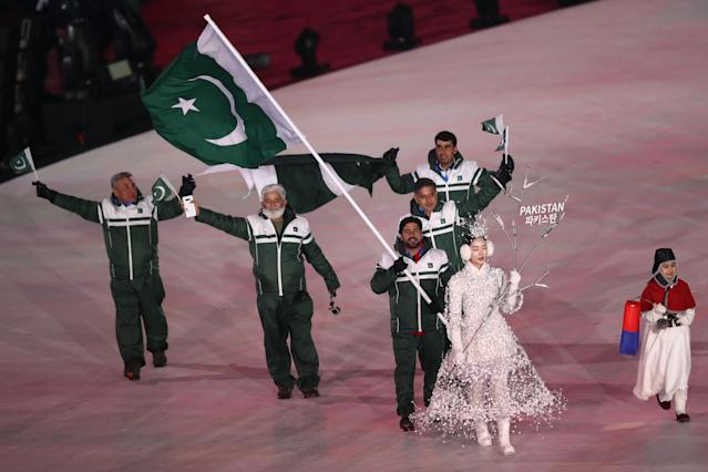 <p>Flag bearer Muhammad Karim of Pakistan leads the team during the Opening Ceremony of the PyeongChang 2018 Winter Olympic Games at PyeongChang Olympic Stadium on February 9, 2018 in Pyeongchang-gun, South Korea. (Photo by Ronald Martinez/Getty Images) </p>