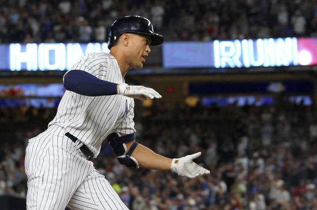 New York Yankees' Giancarlo Stanton rounds third base after he hit a two-run home run during the third inning against the Detroit Tigers in a baseball game Thursday, Aug. 30, 2018, at Yankee Stadium in New York. It was Stanton's 300th career home run. (AP Photo/Rich Schultz)