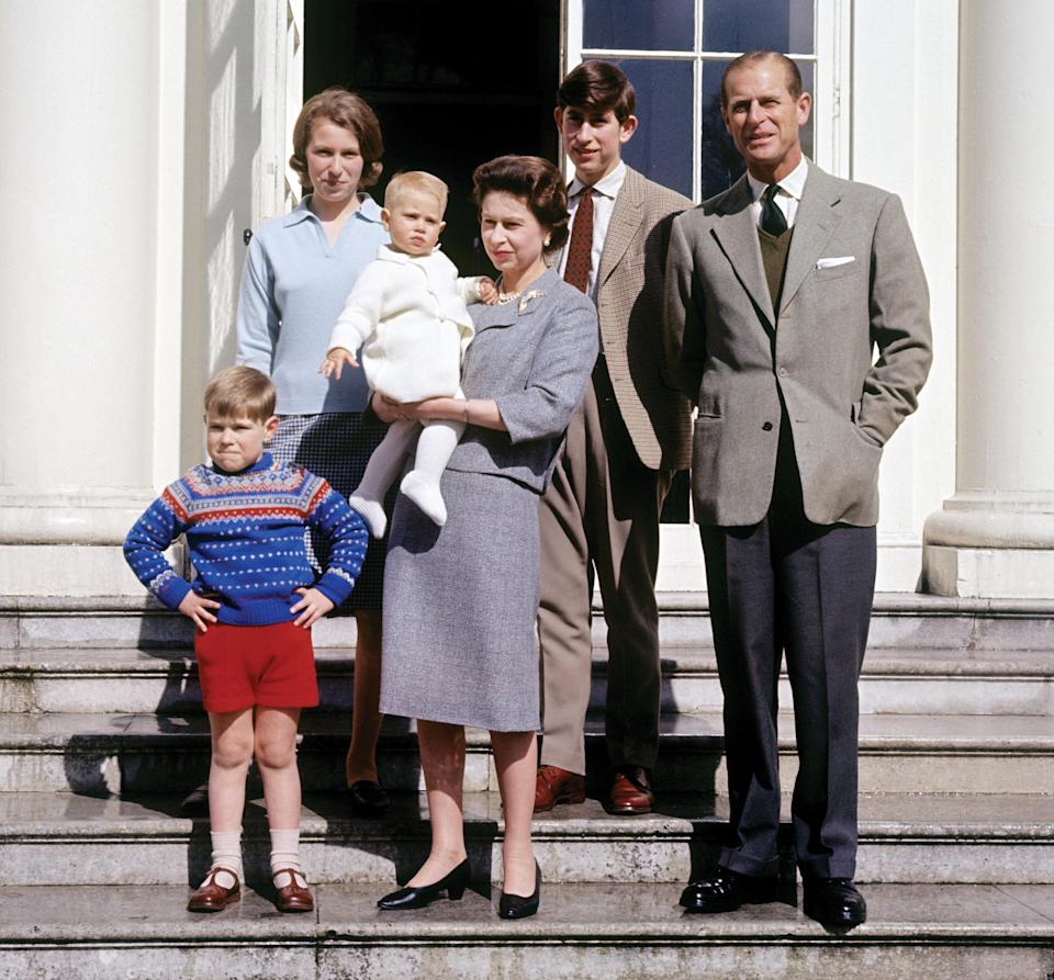 The Queen holding Prince Edward, the Earl of Wessex and the youngest of the couple's children, in 1965, surrounded by Prince Philip and her three other children.