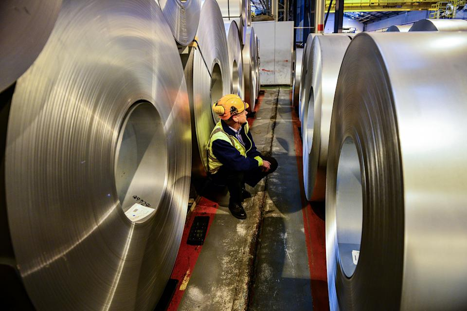 EMBARGOED TO 0001 MONDAY JUNE 10 File photo dated 15/02/17 of a worker inspecting rolls of steel. Optimism among manufacturing firms has slumped to its lowest level in six years, new research suggests.
