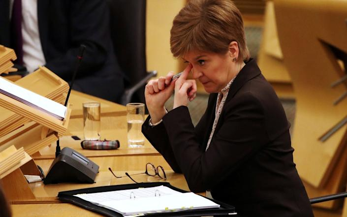 Scottish First Minister Nicola Sturgeon reacts as she delivers a statement at Holyrood, Edinburgh - Andrew Milligan/Pool via Reuters