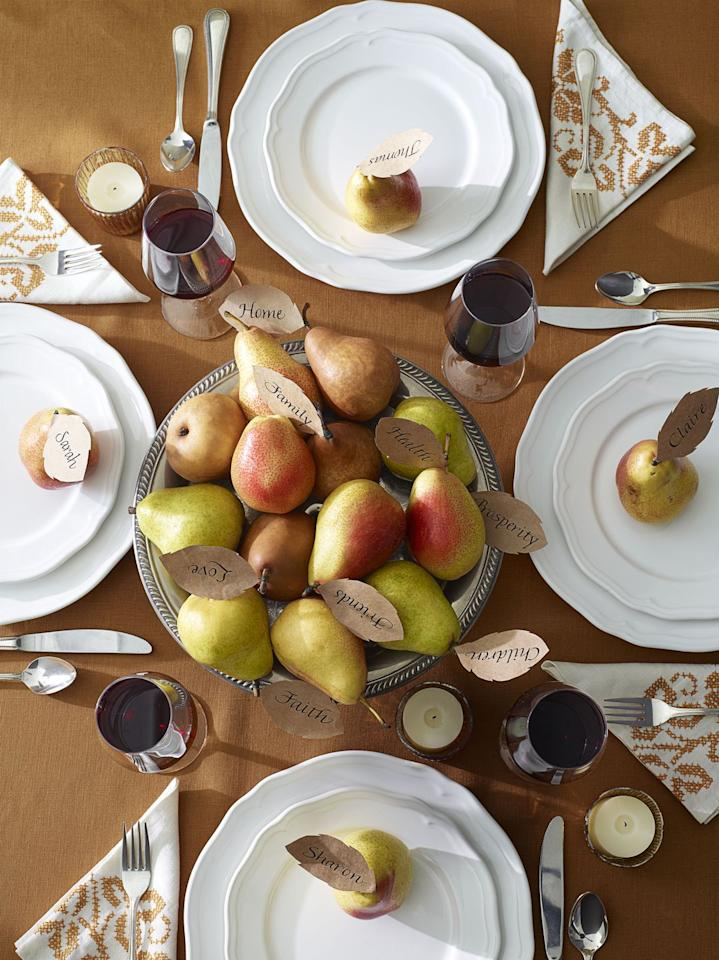 <p>Nestled between pears, paper leaves list what your family is thankful for. After all, that's what the holiday's all about (and the food, of course).</p>