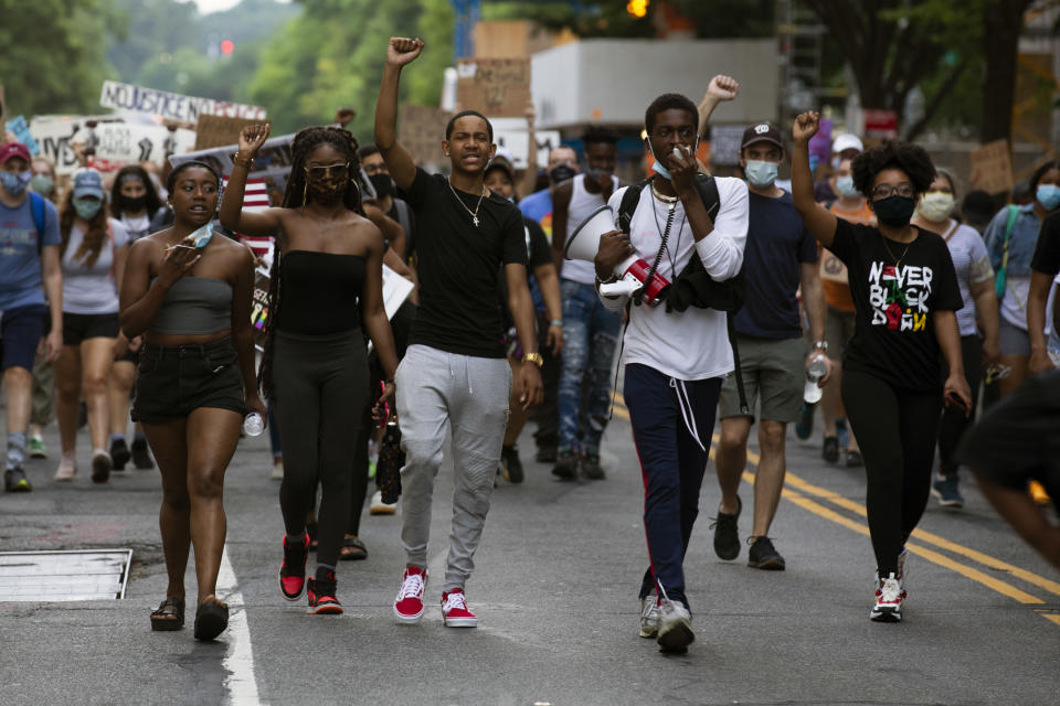 Demonstrators march near the White House, to protest police brutality and racism, on June 10, 2020 in Washington, DC. (Jose Luis Magana/AFP via Getty Images)
