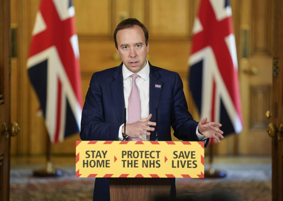 In this photo provided by 10 Downing Street, Britain's Health Secretary Matt Hancock gestures during a coronavirus media briefing in Downing Street, London, Monday,  May 4, 2020. (Andrew Parsons/10 Downing Street via AP)