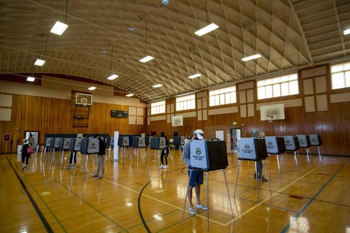 HUNTINGTON BEACH, CA - NOVEMBER 03: People vote at the Huntington Beach City Gym and Pool on election day Tuesday, Nov. 3, 2020 in Huntington Beach, CA. (Allen J. Schaben / Los Angeles Times)
