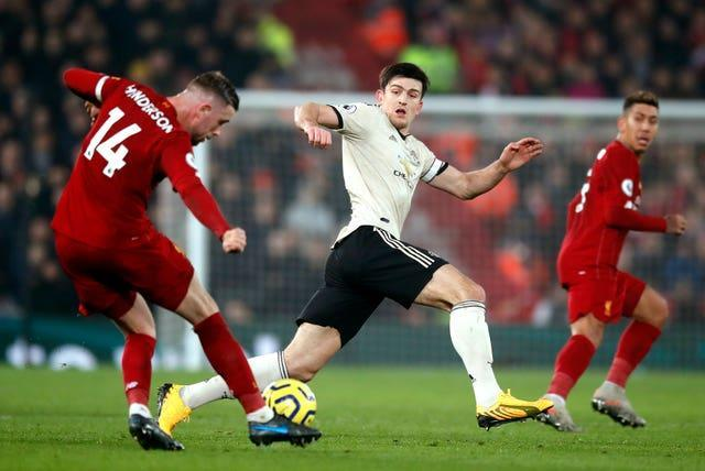 Liverpool captain Jordan Henderson, left, and Manchester United skipper Harry Maguire have been battling fitness problems