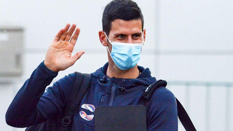 Novak Djokovic is seen here wearing a face mask after flying into Australia.