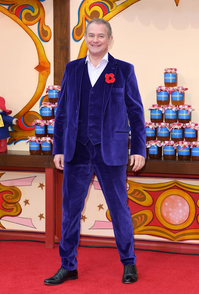 <p>Wearing a purple velvet three-piece suit.<br />[Photo:<i> Getty]</i> </p>