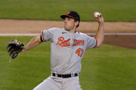 Baltimore Orioles starting pitcher John Means winds up during the second inning of the team's baseball game against the New York Yankees, Wednesday, April 7, 2021, at Yankee Stadium in New York. (AP Photo/Kathy Willens)