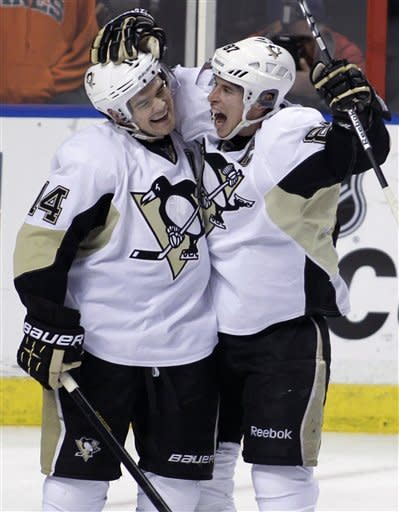 Pittsburgh Penguins' Chris Kunitz, left, celebrates with Sidney Crosby, right, after Kunitz scored against the Florida Panthers during the second period of an NHL hockey game, Tuesday, Feb. 26, 2013, in Sunrise, Fla. (AP Photo/Luis M. Alvarez)
