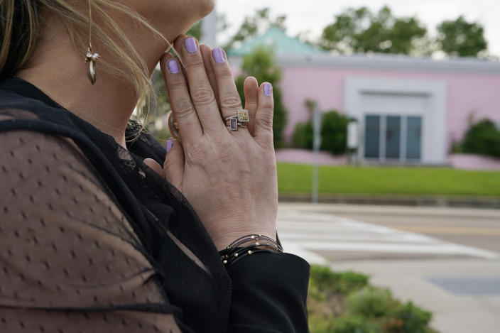 """Sitting across the street from the Jackson Women's Health Organization clinic, more commonly called """"the pink house"""" by area residents in Jackson, Miss., this woman, who has ended two pregnancies at the clinic said she has never had a moment's regret over those decisions, Wednesday, May 19, 2021. At the time, she was in her 30s and did what was best for herself and her young child, she said. (AP Photo/Rogelio V. Solis)"""