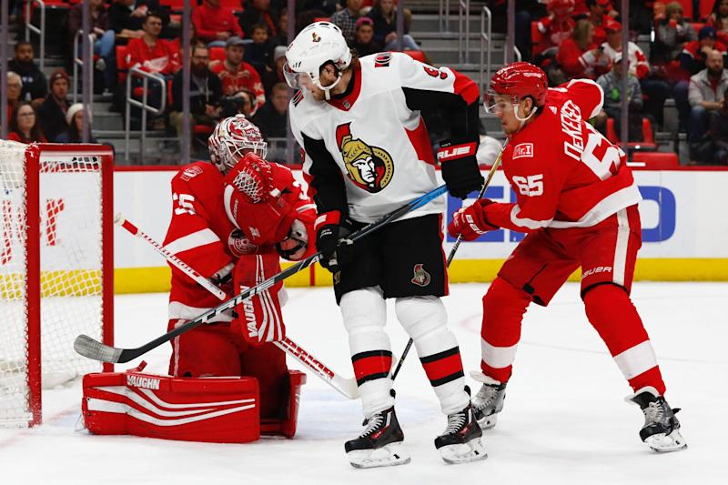 Detroit Red Wings goaltender Jimmy Howard (35) makes a save on a deflection by Ottawa Senators right wing Bobby Ryan (9) in the first period at Little Caesars Arena.