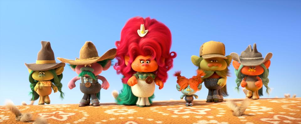 """Delta Dawn (center, voiced by Kelly Clarkson) heads up a crowd of country-loving cowpokes in """"Trolls World Tour."""""""