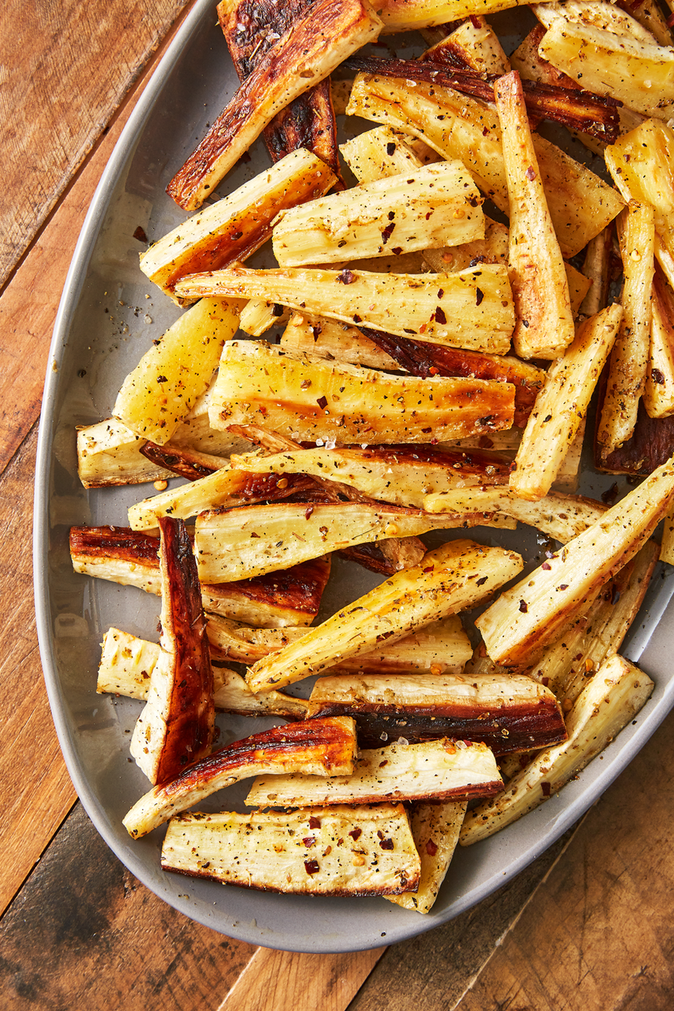 """<p>Parsnips don't get nearly the attention they deserve, but that ends now. Roasting them makes them slightly sweet and perfectly tender for a quick side dish you might love more than the main course.</p><p>Get the <a href=""""https://www.delish.com/uk/cooking/recipes/a29871209/roast-parsnips-recipe/"""" rel=""""nofollow noopener"""" target=""""_blank"""" data-ylk=""""slk:Roasted Parsnips"""" class=""""link rapid-noclick-resp"""">Roasted Parsnips</a> recipe.</p>"""