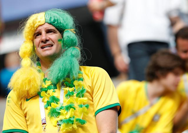 <p>Brazil fan before the match REUTERS/Carlos Garcia Rawlins </p>