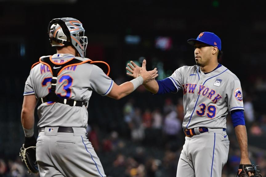 Edwin Diaz and James McCann high five after victory in AZ