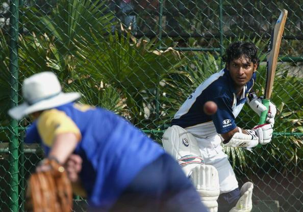GALLE, SRI LANKA - DECEMBER 1: Sri Lankan Coach John Dyson throws the ball to Kumar Sangakkara during Sri Lankan nets at the Galle International Stadium on December 1, 2003 in Galle, Sri Lanka. (Photo by Stu Forster/Getty Images).