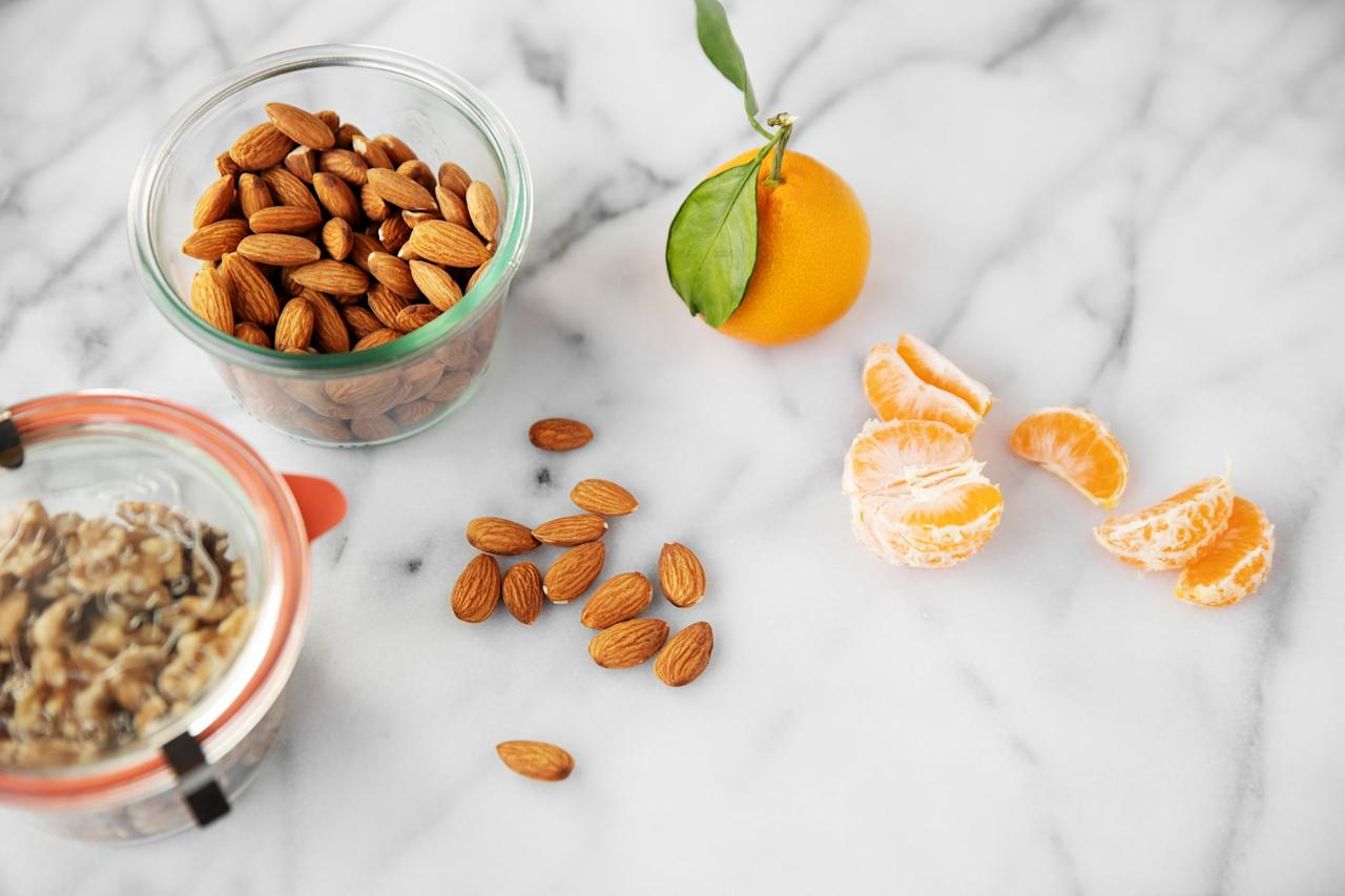"""<p>Almonds, pecans, hazelnuts, and boast a number of benefits. For one thing, they're filling and can provide long-lasting energy, so you're not totally wiped out once you land, Dr. Harry explained. """"Nuts also provide essential fats, proteins, and minerals such as magnesium,"""" she continued. """"This is important because long flights can leave the muscles with a tendency to cramp and become painful. Magnesium can help to counteract this tendency."""" Just avoid varieties with added salt. <a href=""""http://familydoctor.org/condition/edema/"""" target=""""_blank"""" class=""""ga-track"""" data-ga-category=""""Related"""" data-ga-label=""""http://familydoctor.org/condition/edema/"""" data-ga-action=""""In-Line Links"""">Foods high in sodium can cause your body to hold onto excess water</a>, causing your legs and feet to swell.</p> <p>If you're tired of plain nuts, try making your own trail mix. """"If you have a sweet tooth, dried fruits like cranberries are a great addition since they are low-sugar and high in antioxidants, Vitamin C, and fiber,"""" Abbie Gellman, RD, founder of <a href=""""http://www.culinarynutritioncuisine.com/"""" target=""""_blank"""" class=""""ga-track"""" data-ga-category=""""Related"""" data-ga-label=""""http://www.culinarynutritioncuisine.com/"""" data-ga-action=""""In-Line Links"""">Culinary Nutrition Cuisine</a>, told POPSUGAR. Try combining them with walnuts, almonds, popcorn, and sunflower seeds.</p>"""