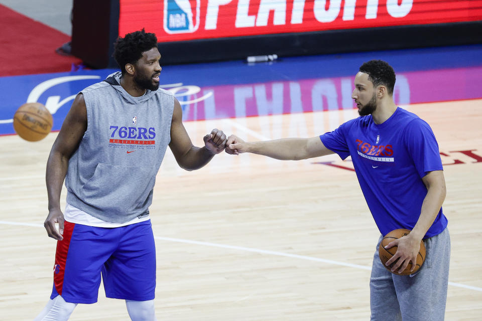 PHILADELPHIA, PENNSYLVANIA - JUNE 02: Joel Embiid #21 and Ben Simmons #25 of the Philadelphia 76ers warm up before playing against the Washington Wizards during Game Five of the Eastern Conference first round series at Wells Fargo Center on June 2, 2021 in Philadelphia, Pennsylvania. NOTE TO USER: User expressly acknowledges and agrees that, by downloading and or using this photograph, User is consenting to the terms and conditions of the Getty Images License Agreement. (Photo by Tim Nwachukwu/Getty Images)