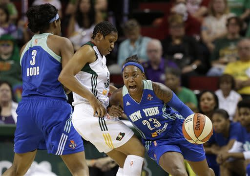 Seattle Storm's Tanisha Wright, center, is caught in a pick by New York Liberty's Kelsey Bone (3) as Cappie Pondexter drives past in the first half of a WNBA basketball game, Friday, June 28, 2013, in Seattle. (AP Photo/Elaine Thompson)