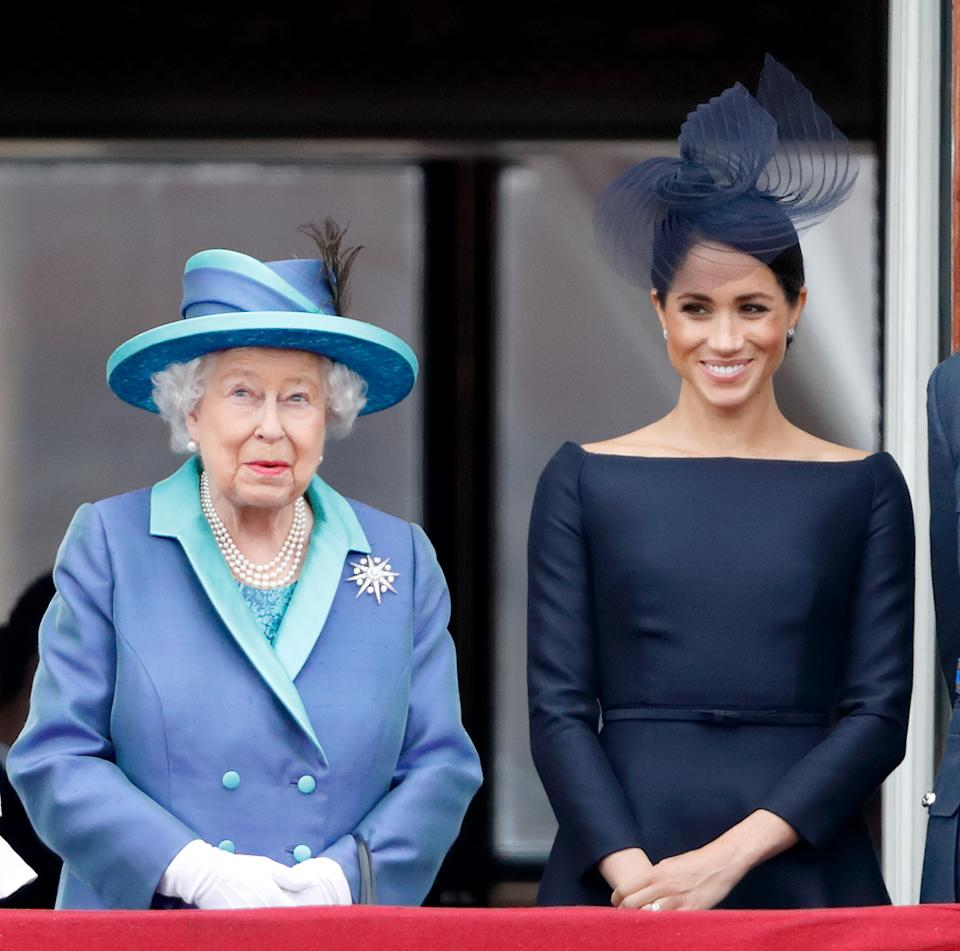 Meghan, Duchess of Sussex, pictured with Queen Elizabeth, is losing her royal title in the Spring after she and Prince Harry decided to scale back on their royal duties. (Photo: Max Mumby/Indigo/Getty Images)