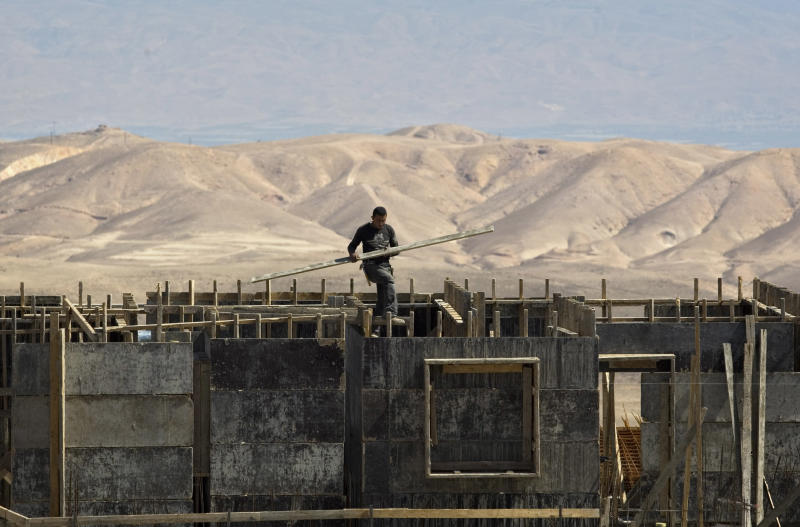 FILE - In this June 23, 2011 file photo, a worker is seen at a construction site in Maale Adumim. A leading rights group is accusing Israeli banks of contributing to the expansion of Jewish West Bank settlements by providing loans and mortgages for construction there. In the report, released Wednesday, Sept. 13, 2017, Human Rights Watch called on Israeli banks to extricate themselves from the settlements or face possible action from shareholders. (AP Photo/Sebastian Scheiner, File)