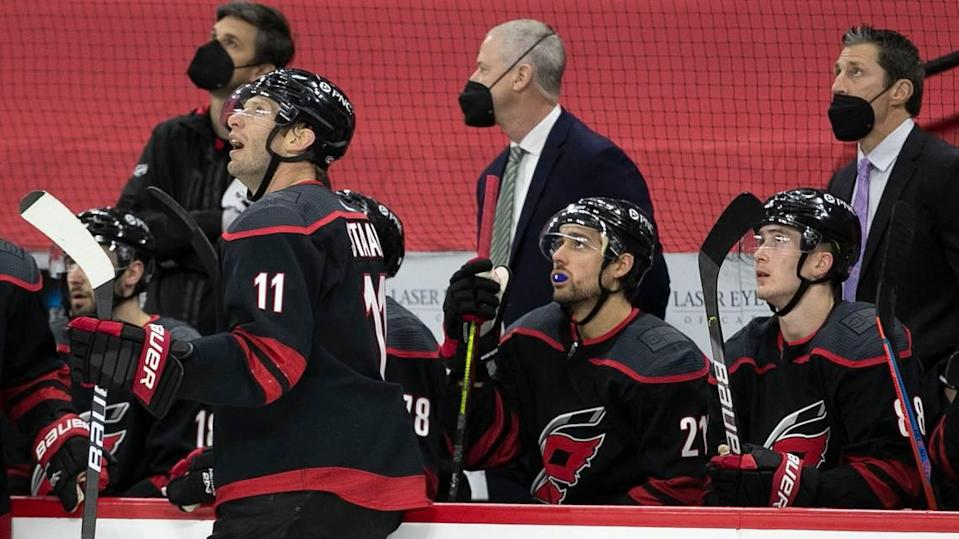 Carolina Hurricanes' captain Jordan Staal (11) and coach Rod Brind'Amour watch the replay of a Columbus goal by Seth Jones (3) in the first period on Thursday, March 18, 2021 at PNC Arena in Raleigh, N.C.