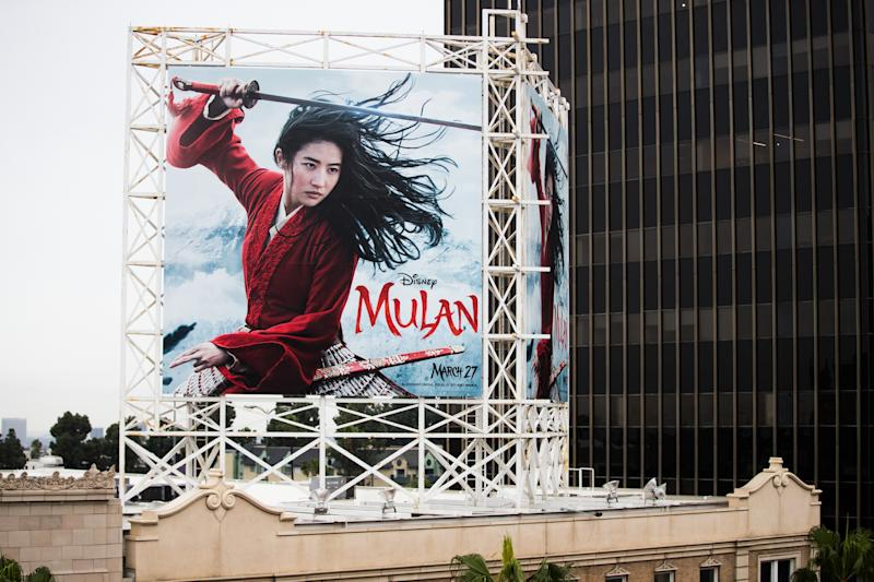 "HOLLYWOOD, CALIFORNIA - MARCH 13: An outdoor ad for Disney's ""Mulan"" is seen on March 13, 2020 in Hollywood, California. The spread of COVID-19 has negatively affected a wide range of industries all across the global economy. (Photo by Rich Fury/Getty Images)"