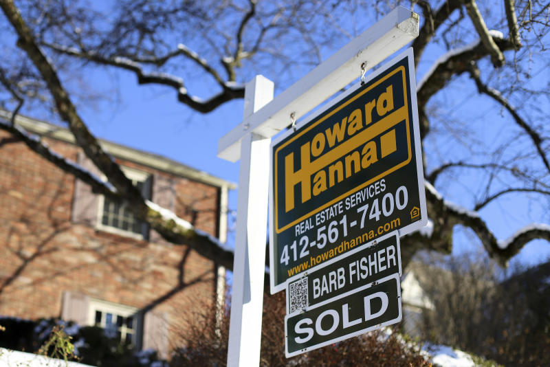 FILE- In this Jan. 14, 2019, file photo a sold sign outside a home in Mt. Lebanon, Pa. Buying a home for the first time is challenging no matter your marital status. But doing so in an unmarried partnership poses unique challenges. (AP Photo/Gene J. Puskar, File)