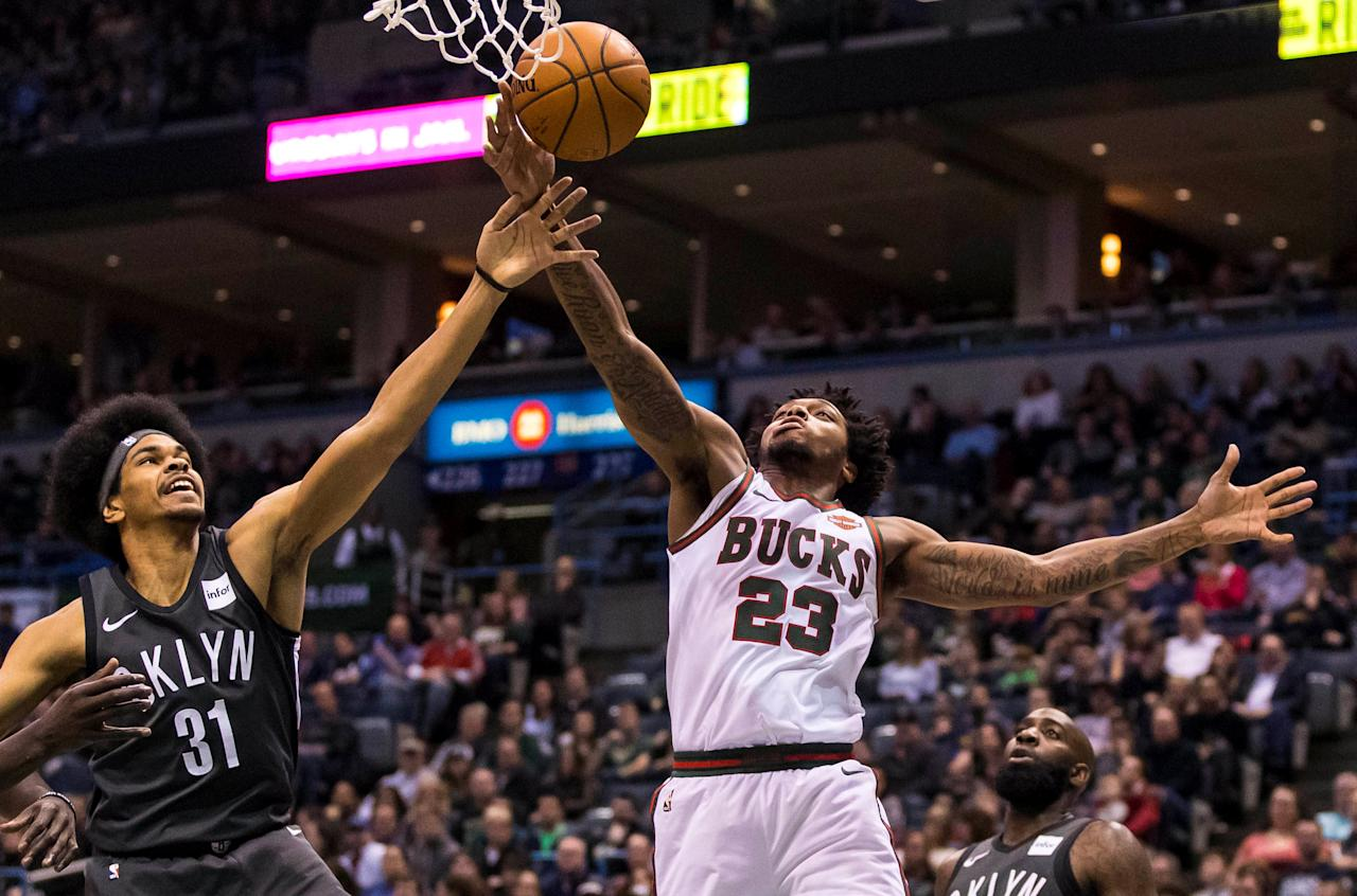 FILE PHOTO: Brooklyn Nets center Jarrett Allen (31) and Milwaukee Bucks guard Sterling Brown (23) reach for a rebound during the first quarter of NBA basketball game in Milwaukee, Wisconsin, U.S., January 26, 2018.  Mandatory Credit: Jeff Hanisch-USA TODAY Sports /File Photo