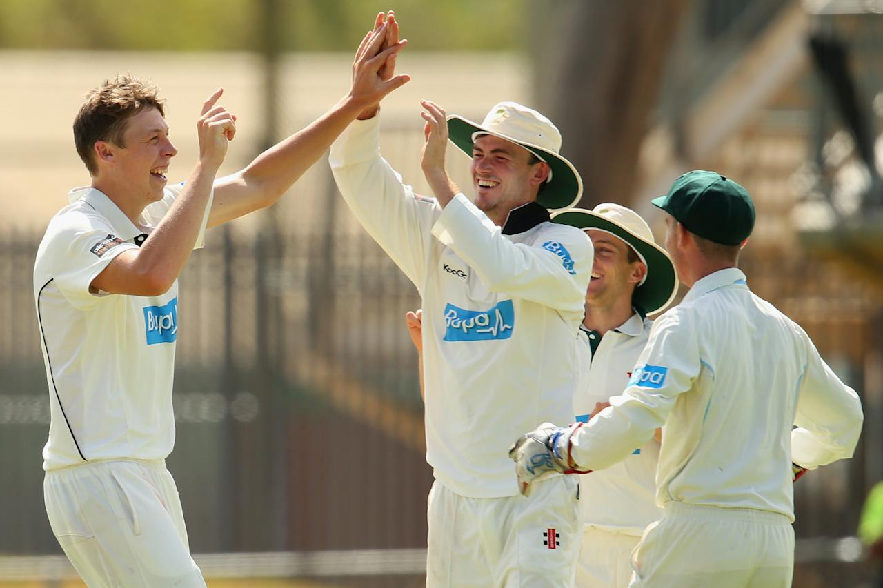 ALICE SPRINGS, AUSTRALIA - NOVEMBER 29:  Simon Mackin of the Chairman's XI celebrates with his team after taking the wicket of Ian Bell of England during day one of the tour match between the Chairman's XI and England at Traeger Park on November 29, 2013 in Alice Springs, Australia.  (Photo by Mark Kolbe/Getty Images)