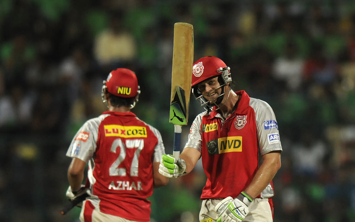 Adam Gilchrist captain of Kings XI Punjab raises his bat after scoring a half century during match 63 of the Pepsi Indian Premier League between The Royal Challengers Bangalore and The Kings XI Punjab held at the M. Chinnaswamy Stadium, Bengaluru  on the 14th May 2013..Photo by Pal Pillai-IPL-SPORTZPICS  ..Use of this image is subject to the terms and conditions as outlined by the BCCI. These terms can be found by following this link:..https://ec.yimg.com/ec?url=http%3a%2f%2fwww.sportzpics.co.za%2fimage%2fI0000SoRagM2cIEc&t=1503496614&sig=j57hB0CTdgsrPFENkahKOA--~D