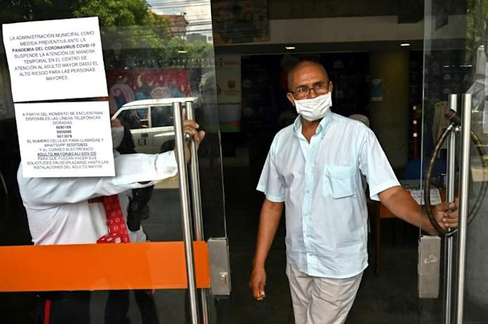 A worker wears a mask in Cali. Though still low in terms of global figures, the number of cases in Latin America grew steadily to reach more than 250 in 15 countries, with three deaths (AFP Photo/Luis ROBAYO)