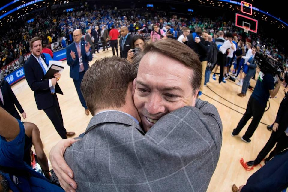 """Saint Louis University men's basketball coach and former Kentucky Wildcats point guard Travis Ford, facing forward, hugged his nephew and assistant coach Ford Stuen after the Billikens won the 2019 Atlantic 10 Conference Tournament championship. Stuen died May 11 at age 29 after falling ill with what Travis Ford says began as """"a severe liver issue."""""""