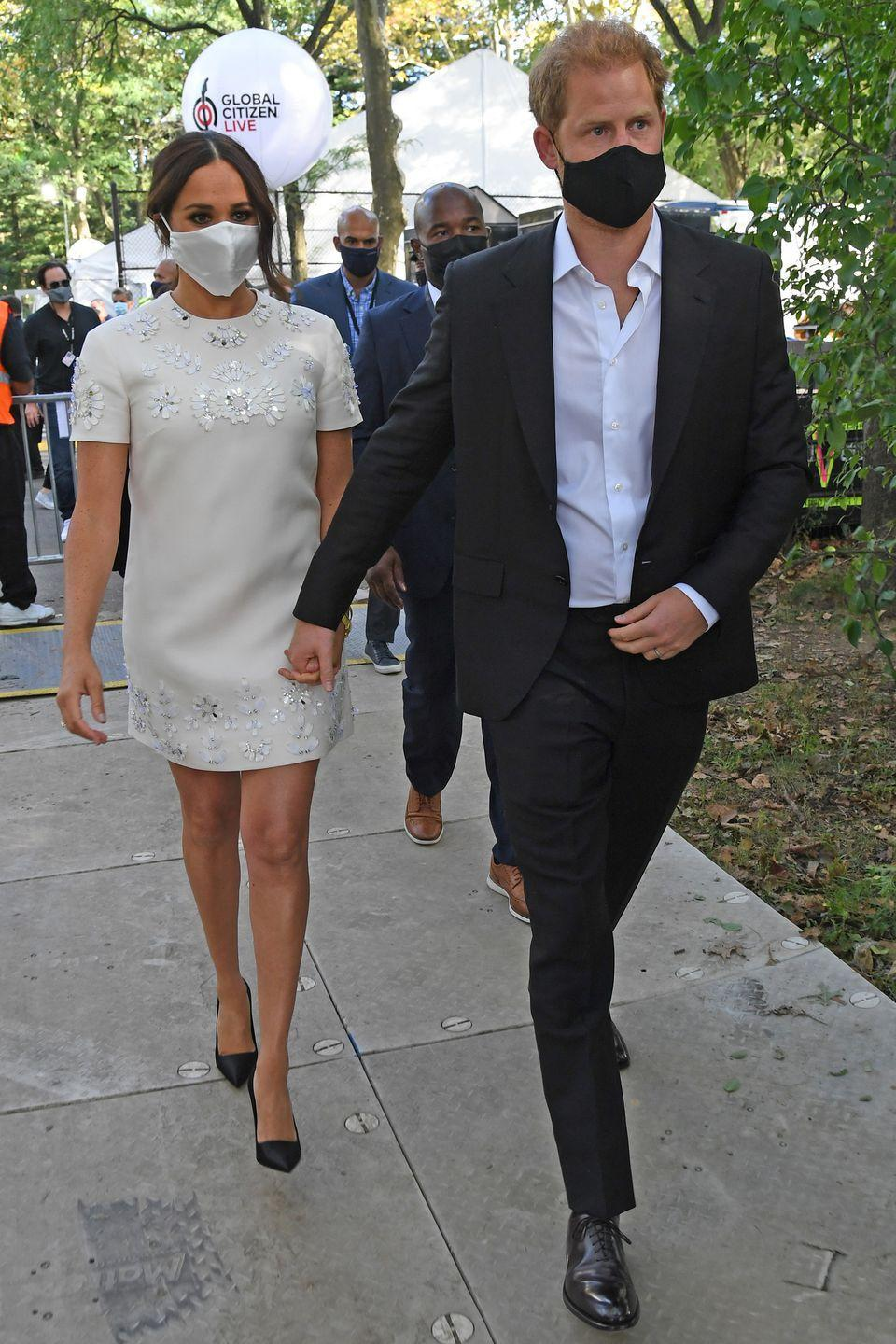 <p>Meghan paired her Valentino mini-dress with a pair of black pointed court heels. </p>