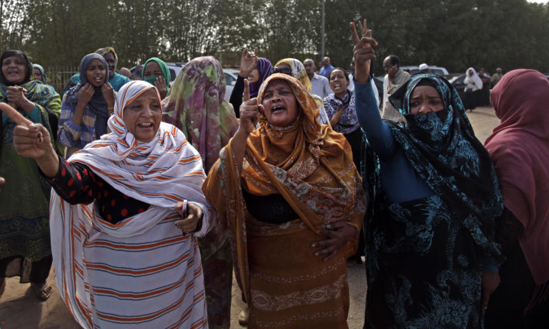 Sudanese relatives of Salah Sanhory, 26, who was killed Friday Sept. 27 by the security in an anti-government protest, mourn during his funeral in Khartoum, Sudan, Saturday, Sept. 28, 2013. The regime of President Omar al-Bashir is trying to stop public anger over fuel price hikes from turning into an Arab Spring-style uprising against his 24-year rule. But a crackdown by security forces appears to be fueling the unrest.(AP Photo/Khalil Hamra)
