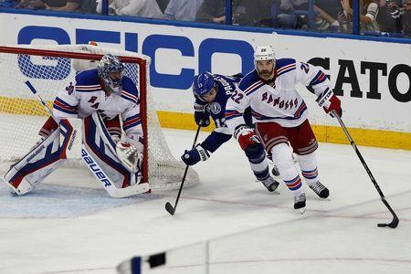 New York Rangers defenseman Dan Boyle (22) skates with the puck past Tampa Bay Lightning center Cedric Paquette (13) and Rangers goalie Henrik Lundqvist (30) during the third period in game three of the Eastern Conference Final of the 2015 Stanley Cup Playoffs at Amalie Arena. Mandatory Credit: Reinhold Matay-USA TODAY Sports