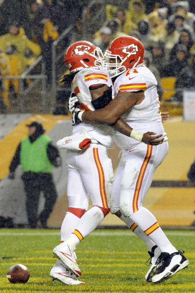 Kansas City Chiefs running back Jamaal Charles (25) celebrates with guard Jeff Allen (71) after scoring a first-quarter touchdown against the Pittsburgh Steelers in an NFL football game, Monday, Nov. 12, 2012, in Pittsburgh. (AP Photo/Don Wright)