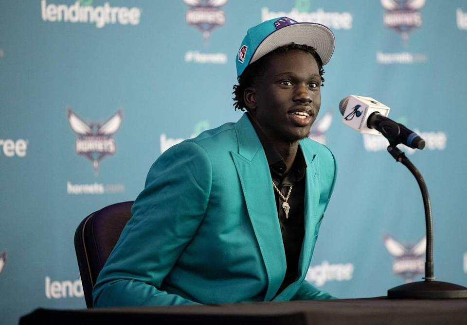 Charlotte Hornet second-round draft pick J.T. Thor speaks during a press conference at the Spectrum Center in Charlotte on Friday. Thor said he already owned the suit in Charlotte colors that he wore to the news conference.