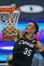 Cleveland Cavaliers' Isaac Okoro dunks against the Chicago Bulls during the second half of an NBA basketball game Wednesday, April 21, 2021, in Cleveland. (AP Photo/Tony Dejak)