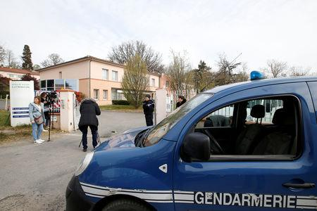 "French gendarmes stand at the entrance of the ""La Cheneraie"" EHPAD (Housing Establishment for Elderly Dependant People) care home following the deaths of five people as a result of suspected food poisoning in Lherm, southern France, April 1, 2019.  REUTERS/Regis Duvignau"